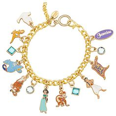 Summon the style of a Sultan's daughter wearing Jasmine's golden costume jewelry link chain bracelet with nine cloissoné charms of characters and icons from Aladdin, plus sparkling gemstone pendants.