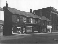 View of Deansgate Head Post Office, Bakers, Tobacconist, Hairdressers and Furnishing Warehouse. Deansgate 2 Location Town Centre, Bolton Date 1957.
