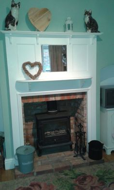 Firefox wood burner with 1930's painted fire surround