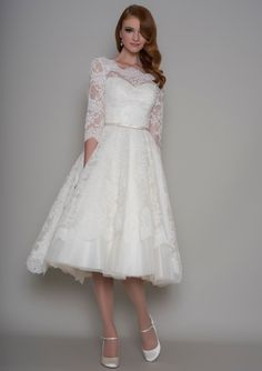 Gorgeous lace gown with 3/4 length lace sleeve from LouLou Bridal
