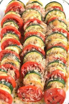 Parmesan Tomato Zucchini Bake is a simple recipe with layered fresh tomatoes, zu. Parmesan Tomato Zucchini Bake is a simple recipe with layered fresh tomatoes, zucchini and summer squash topped with garlic, onions and parmesan cheese! Tomato Zucchini Bake, Baked Parmesan Tomatoes, Zucchini Parmesan, Zuchinni Bake, Zuchinni Recipes, Zucchini Casserole, Zucchini And Onion Recipe, Baked Zucchini Recipes Healthy, Cheesy Zucchini Bake