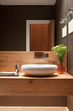 Just looking at combination of timber and white basin (not that shape) for powder room