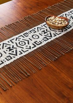 These African table runners are created by weaving dried twigs through through hand-dyed mud cloth fabric. Handmade Table, Handmade Home Decor, Diy Home Decor, Room Decor, Farmhouse Side Table, Cool Rooms, Home Decor Kitchen, A Boutique, Cool Kitchens