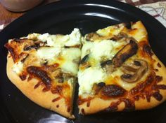 Balsamic Chicken Pizza: Leftover Trader Joe Balsamic Chicken, a fresh pizza dough from Roche Bros, sauteed mushrooms, ricotta cheese, pasta sauce, mozzarella cheese and parmesan cheese. Bake for 25 minutes at 350 degrees. Plus my homemade pizzas average just 300 calories a slice!