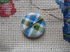Never lose a needle again! This beautiful blue/green plaid needle minder is made with wooden buttons and strong magnets! The back magnet has Needle Minders, Magnets, Blue Green, Strong, Plaid, Buttons, Beautiful, Gingham, Duck Egg Blue