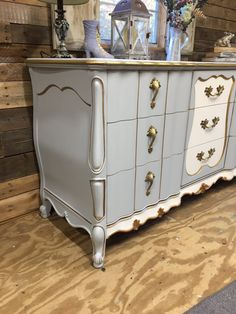 French Provincial Dresser. This beautiful detailed French dresser has 9 easy glide deep spacious drawers. I used all general finishes products on this piece including the hardware. I painted the Base-Baby Blue & Snow White w/Champagne Pearl Effects. Hardware-Layered on Bronze &
