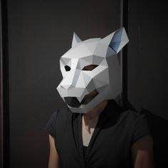 These plans and instructions enable you to make your own super cute 3D Jaguar Mask from cardboard. This mask is simple to make and the construction