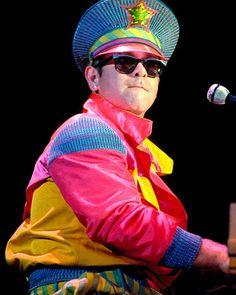 - elton john´s pics: Photos: Elton John's Outfits Through the Years Fotos de elton john: Fotos: Elton John's Outfits for Years. Pop Punk, Sherlock, Elton John Costume, Elton Jon, Terry O Neill, Morrison Hotel, Captain Fantastic, Animal Costumes, Record Producer