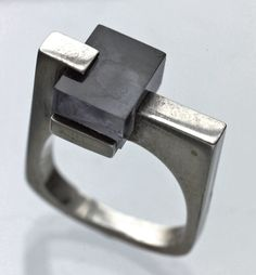 Really neat geometric design with what looks like silver and concrete. I'm boggled as to how it was constructed, though!   Constructivist #French ring - c. 1965