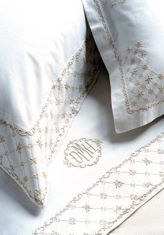Hand embroidered custom bed linens by Léron. View our collections including custom embroidered sheets, shams, pillow cases, duvet covers, and throws.