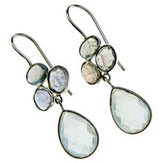 You will enjoy the hand crafted elegance and feel of these teardrop shaped moonstone and labradorite earrings. These earrings make a great versatile addition to your jewelry box.