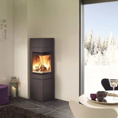 QUADRO 2 - Wood heating stove / corner / metal / contemporary by Nordpeis Corner Wood Stove, Corner Gas Fireplace, Stove Fireplace, Fireplace Design, Modern Wood Burning Stoves, Indoor Outdoor Fireplaces, Small House Decorating, Wood Burner, Home And Living