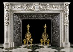 A small 19th century Carrara Marble Chimneypiece Mantel in the Italian Renaissance Manner richly carved in high relief, together with it's original cast iron insert.The frieze, centred by a merman and mermaid flanking an elaborate strapwork cartouche, depicts a pair of birds set amongst scrolling fruits and flowers symbolising Peace and Abundance. The endblocks with tall garlanded cartouche above extraordinary tripedalism satyr grotesques holding beaded garlands in their mouths