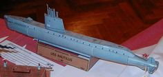 This paper model is a simple USS Nautilus (SSN-571), the world's first operational nuclear-powered submarine, the papercraft is created by ABC, and the scale is in 1:400.  The vessel was the first submarine to complete a submerged transit of the North Pole on 3 August 1958.