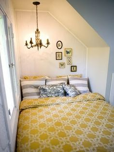 gray and yellow bedroom, cozy in a tight space. had a nook like this with my bed in it before.  I miss it.