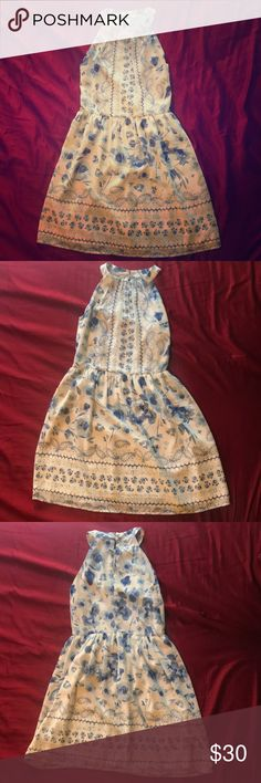 Skies Are Blue blue and white floral dress Skies Are Blue brand blue and white floral dress. Only worn once, altered at the waist to fit slimmer for a more flattering look. Skies Are Blue Dresses
