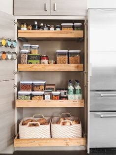 Kitchen Organization Tip: Create a pantry with sliding shelves. There will be no more shuffling through small cabinets to find the right ingredient. Find this look in the Martha Stewart Living Kitchens line only at The Home Depot.