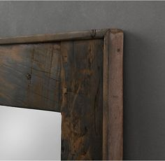 RH's Salvaged Boat Wood Mirror:Salvaged from antique fishing boats, the wood planks that frame our mirror earned their one-of-a-kind character on the waves of the South China Sea. Finished only with a light sanding, the wood features naturally high-contrast grain along with random bolts and joinery that remain from the boats' construction.
