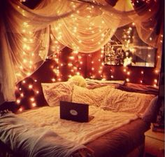 Fairy lights around the bed :) Great idea for a little girls room, comfy,cozy for those bedtime stories.