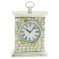 Aluminum mantel clock with Roman numerals.Product: Clock    Construction Material: Aluminum and capiz shell    Color: Mother of pearl   Features:  Mosaic detail    Streamlined silhouette    Will enhance any d�cor  Accommodates: Batteries - not included   Dimensions: 9 H x 7 W x 2 D