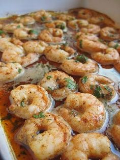 Spicy Baked Shrimp: 1/2 cup olive oil, 2 tbsp Cajun or Creole seasoning, 2 tbsp fresh lemon juice, 2 tbsp chopped fresh parsley, 1 tbsp honey, 1 tbsp soy sauce, pinch cayenne pepper, 1 lb uncooked large shrimp, shelled, deveined, refrigerate 1 hour, bake 450°F until shrimp cooked through ~ 10 min, garnish w/ lemon serve w/ French bread