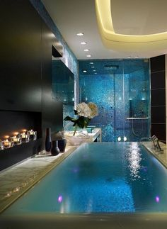 This infinity edge spa bathtub is breathtaking-and so is the rest of this luxurious master bathroom! 2015 Bathtub Trends-From Our Blog at Design Connection, Inc. | Kansas City Interior Design http://www.designconnectioninc.com/inspired-design-top-bathtub-trends-of-2015/