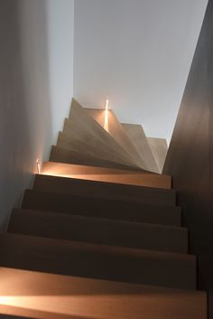 Illuminated wood staircase by Co. Studio -- these are beauties, and I would probably bounce off each one as I fell all the way down them --