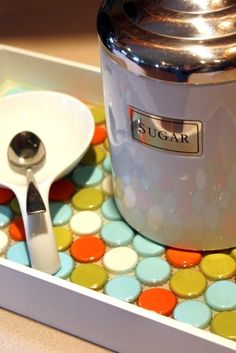 i LOVE this bottle cap tray! the colors used are awesome! orange, blue, green  and white! oh my!