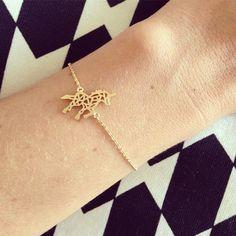 Une licorne + un bracelet tout fin = <3