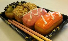 Psycho Psushi (aka a bento box with 4 pieces of doughnut sushi and edible chopsticks) from Psycho Donuts.