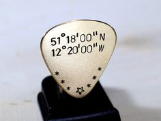 Guitar Picks - This bronze guitar pick was cut from 20 gauge bronze and will be personalized with the latitude and longitude of your choosing by writing your coordinates or city under the notes to seller section dur