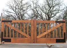 This single swing gate is painted to look like stained Western Red Cedar, but no wood was used to build this custom gate. It ready for the client to pick up and take to his ranch in Prague, Oklahoma. We would love to to design and build your perfect driveway gate. Faux Wood Paint, Security Gates, Iron Gate Design, Custom Gates, Farm Gate, Double Gate, Modern Ranch, Driveway Gate, Outdoor Spaces