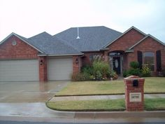 Brick red house exterior eggshell stone and brick exterior . brick red house exterior exterior house color schemes with red brick brick and