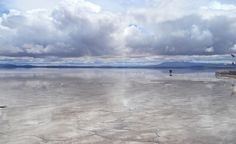 The Bolivian Salt Flats are said to have been created about 30,000 years ago when Lago Minchin dried up, leaving the salt behind. A thin layer of water spread over the flats during the rainy season to create the illusion of a never-ending mirror. (From: Photos: 10 Places That Are Out of this World )