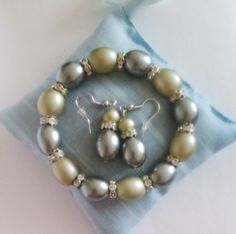 silver and grey-green oval earrings and bracelet set  £6.65