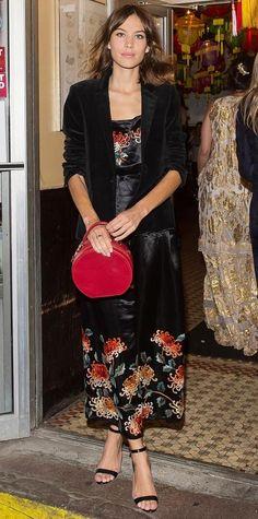 Alexa Chung in an embroidered black silk slip dress and velvet blazer.