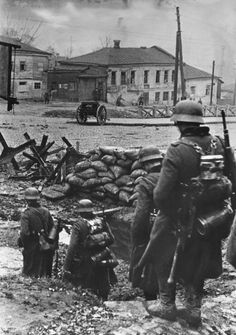 German soldiers of the 57. Infanterie-Division passing through one of the barricades which blocked Sverdlov Street, the main road into the city from the west
