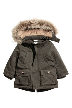 Check this out! Padded parka with a soft finish, a pile-lined, detachable hood with a faux fur trim, and wind flap with a hook and loop fastener and zip down the front. Fake top pockets, patch front pockets with a flap and fastener, and knitted ribbing at the cuffs. Slightly longer at the back with a single back vent. Lined. - Visit hm.com to see more.