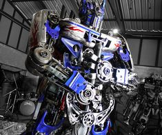 Make your backyard your neighborhood's center of attraction with this giant Optimus Prime metal sculpture. This imposing work of art is expertly handmade entirely from recycled metal and old car parts in the likeness of the iconic Autobot.