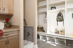 Mud room with dog shower in new construction single family home in the Shadow Creek neighborhood in Lebanon, PA by Garman Builders. See more mud room inspiration at http://www.houzz.com/ideabooks/51303319/thumbs/mudrooms-and-laundry