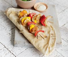 barbecued kebab skewers with halloumi & peppers, served with pitta breads, salad & mayonnaise