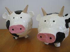 2012- Twin cow paper mache piggy banks