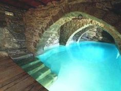Unique indoor swimming pool in a tunnel underneath or next to the house!  One of our most pinned images!