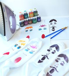 DIY sock painting.  Draw a design on paper, paint it with special paints (Decoart Ink Effects), wait for it to dry and iron on our fabric.  The advantage of doing your design on paper first is that you don't ruin the fabric if you make a mistake.  Just use ordinary copier or printer paper.  You can even print designs if you are not very artistic.