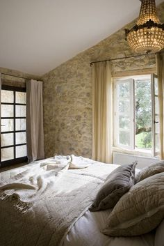Romantic bedroom with weathered stone wall, antique crystal chandelier, and French farmhouse charm. French Farmhouse Decor Inspiration Ideas will take you on a romantic tour of images capturing this charming decor style. Farmhouse Style Bedrooms, French Country House, Beautiful Bedrooms, Modern Country Style, Home, French Farmhouse Decor, Home Bedroom, Stone Houses, French Country Bedrooms