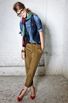 For a quirky look match denim under a vest, tan pants add a scarf and fun accessories