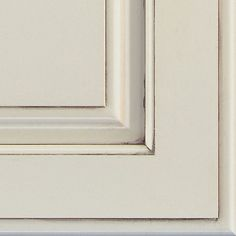 Chantille Espresso glazed cabinet finish on Maple is a warm, off-white hue, with dark brown glazing details.