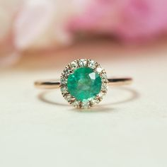 This is the one. Someday. Someday :/    https://www.etsy.com/listing/257669301/custom-emerald-engagement-ring-rose-gold