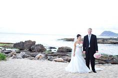 The newlyweds on the beach at JW Marriott Ihilani Resort & Spa.