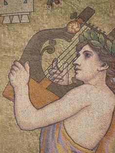 The Muse Euterpe, one of the pair who preside over music; in her case, secular songs and elegaic poetry. From a mosaic decorating the exterior of the 1908 Salle Rameau concert hall in Lyon, France. Wikimedia Commons photo by GO69, shared under Creative Commons license, details @ http://creativecommons.org/licenses/by-sa/3.0/deed.en .
